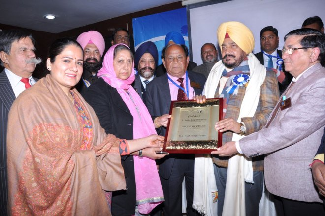 Punjab Forest and Wildlife Preservation Minister Sadhu Singh Dharamsot being honoured at the District Conference.
