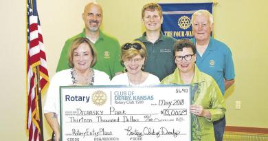 Rotary officials present a ceremonial cheque to the city at their meeting for the purchase and installation of trees at the upcoming Decarsky Park. Front row, from left: Dana Quigley, Rotary president; Vicki Decarsky, park donor and Rotarian; and Kathy Sexton, city manager and Rotarian. Back row, from left: Rob McDonald, Rotary Public Relations Chair; Eric Gustafson, President-elect; and Ken Mulanax, past president. Photo: David Dinell/Derby Informer