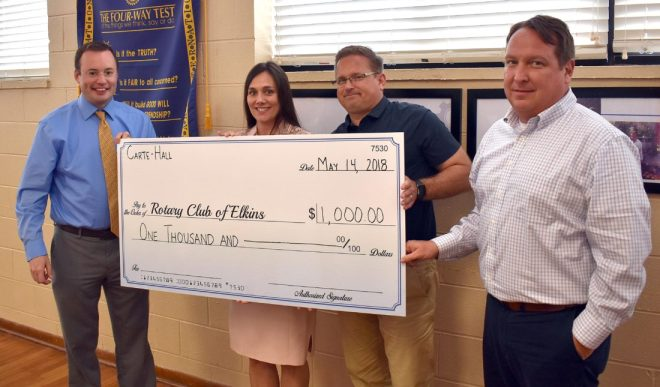 Owners of Carte-Hall Certified Public Accountants in Elkins present the Rotary Club of Elkins with a $1,000 cheque donation for the club's amphitheatre project in the Elkins Town Square during a meeting. From left are Hoy Ferguson, Elkins Rotary past president; Heather Hall; John Carte; and Carl Nichols, Rotary President.