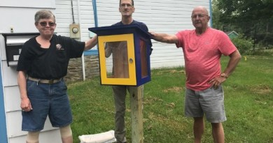 Dansville Rotarians Nancy Nice, Edgar Schmidt and Jon Shay with the first Little Library. Photo: Jasmine Willis
