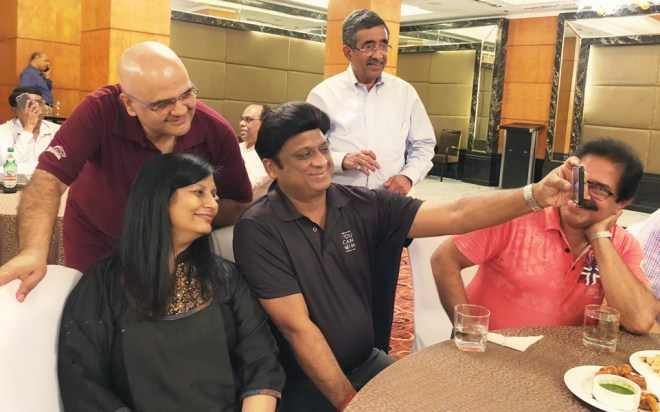 IPDG Vivek Kumar takes a selfie with DGs Rajiv Sharma and Pinky Patel as PDG T N Subramanian looks on.