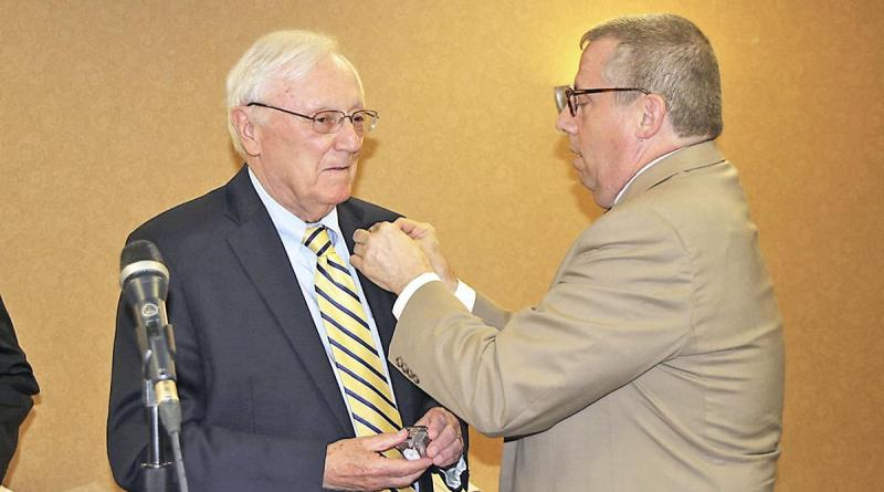 Outgoing Washington Rotary President Richard Podgurski, right, inducts new President William Price during the club's birthday celebration and President's Night on June 12.
