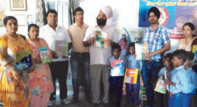 Rotarians of D 3090 with students after installing library in a school.
