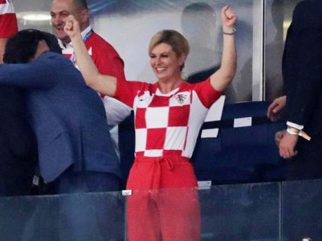 Croatian prez celebrates The Croatian President Kolinda Grabar-Kitarovic joined her country's team in the dressing room to party after Croatia entered the semi-final of the World Cup, to face England. Earlier she was spotted seated with the Croatian fans in the stands and was invited to the VIP area, where the 50-year-old was seen lustily cheering every goal of her team and the nail-biting penalty shoot-out, which ensured Croatia's victory against home team Russia. As soon as the match was over, she rushed to the players' dressing room and embraced each one of them in a congratulatory hug.