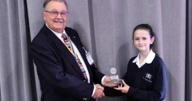 David Coker, chair of Farnham Rotary Youth Committee, with winner Helena Livsey-Hammond.
