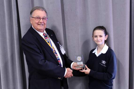 David Coker, chair of Farnham Rotary Youth Committee, with winner Helena Livsey-Hammond.