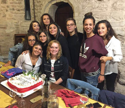 Sydney Moore (Centre) with members of one of the two host families she lived with during her time in Italy as a Rotary club exchange student. Photo: Submitted