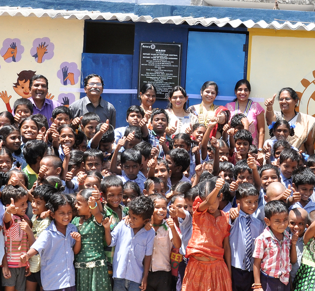 PDG Rajyalakshmi Vadlamani (right) and DGN Pandi Sivannarayana Rao (second from left) with members of RCs Guntur Aadarsh and Parchur Central after inauguration of toilet block in a school.