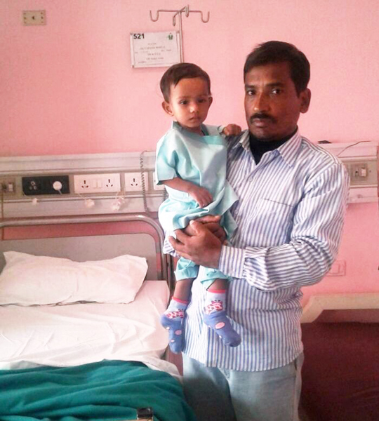 Taposhi Baruah with her father at the hospital room.