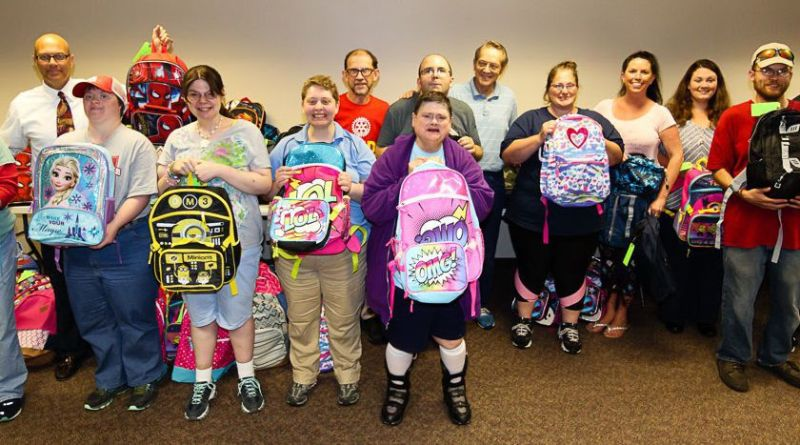 CCAR clients and members of the Charleston Rotary Club again this year are providing backpacks for local foster children. Photo: Submitted