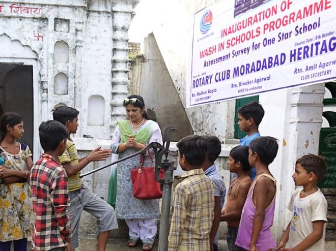 President of RC Moradabad Heritage Madhuri Gupta teaches children the right way of washing hands.