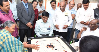 IPDG G N Prakash playing a game of carrom with an inmate at the hospice.