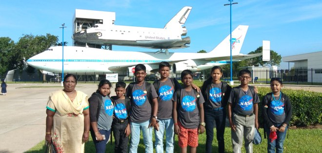 The eight winners of the Wings to Fly contest with the Assistant Educational Officer Rohini at the NASA campus in the USA.