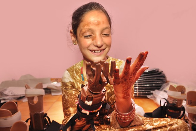 Little Afsha Tabassum admiring her 'new hand'.
