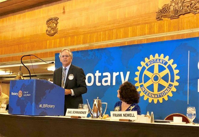 Rotarian Frank Newell talks about Long Beach Rotary's efforts while club president Gail Schwandner listens. Photo: Amy Orr, Gazette