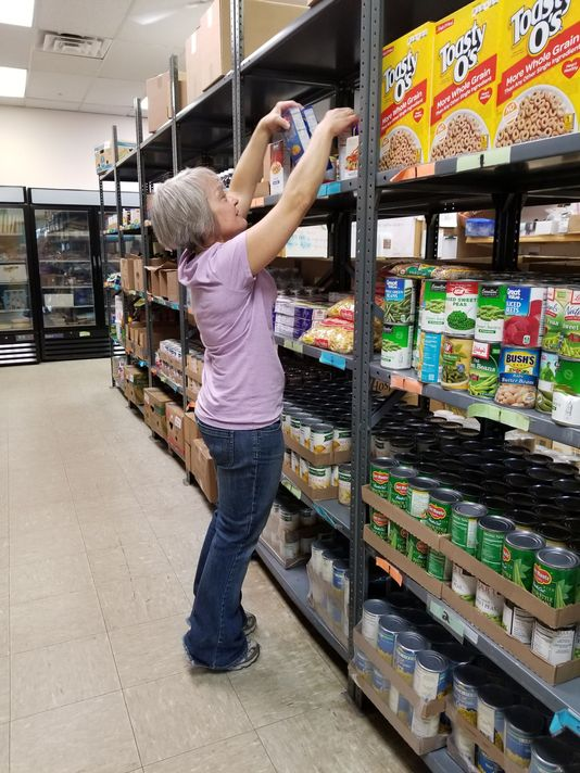 Volunteer Cindy Etringer stocks shelves at the St.Vincent de Paul food pantry in Marshfield. Photo: Caitlin Schulz/USA Today Network-Wisconsin