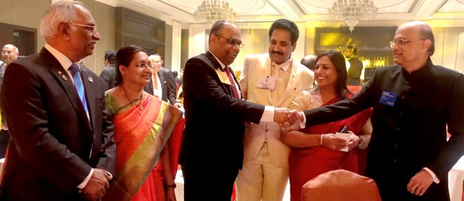 Institute Chairman ISAK Nazar greets TRF Trustee Gulam Vahanvaty as (from L) PDG J B Kamdar, Mala Basker, PDG John Daniel and his wife Meera look on.