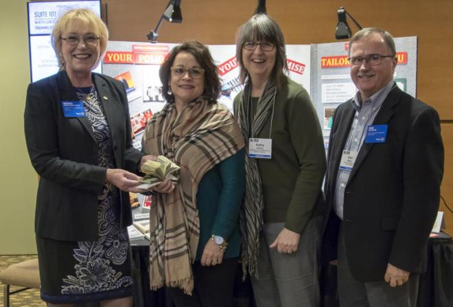 Brenda Cressey, Vice-Chair of the Rotary Foundation Trustees, left, accepts gifts totalling $2,000 for the eradication of polio from Lisa Pritchard, Cedar Rapids Daybreak Rotary Club, and Kathy Getting, Webster City Rotary Club. Don Meyer of Waverly, right, is District 5970's 2018 Foundation Team leader.