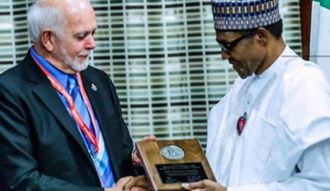 Nigerian President Muhammadu Buhari receiving the Polio Champion Award from Rotary International President Barry Rassin. Twitter photo