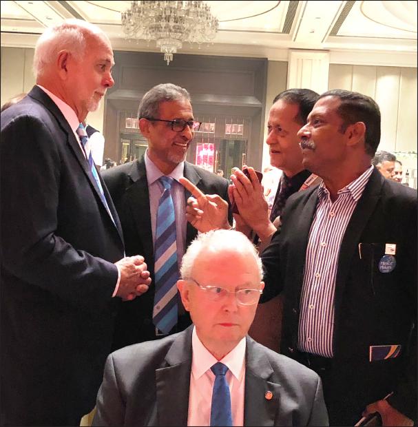 Rtn Ravi Shankar in conversation with President Rassin, DG Suresh Hari and PDG Keshav Kunwar. TRF Trustee Mike Webb is in the foreground.