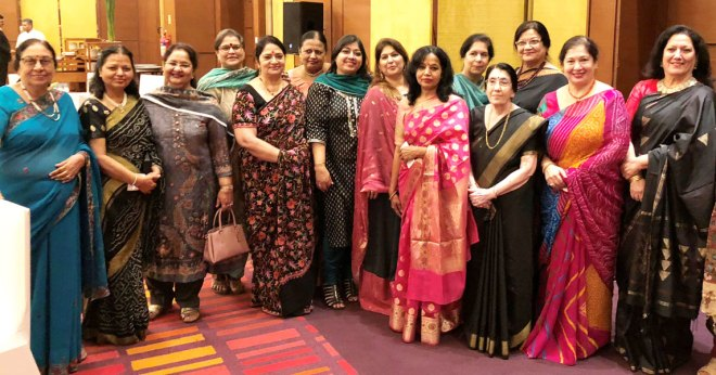 Usha Saboo with Rotarian spouses at a dinner hosted by the Saboo family.