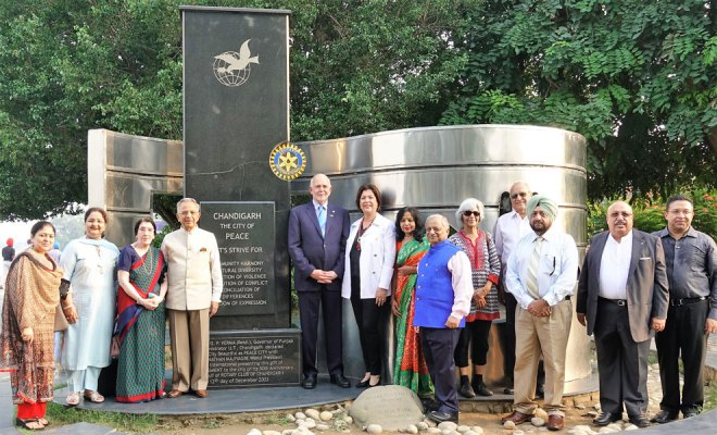 RI President Barry Rassin, Esther, PRIP Rajendra Saboo, Usha, DG Praveen Goyal, Basu and PDGs and spouses at the Peace Monument in Chandigarh.