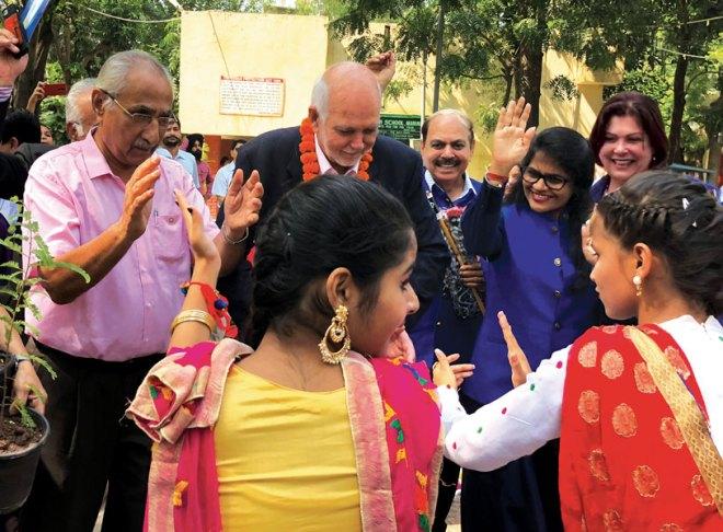 the girls teach President Rassin a few Bhangra steps