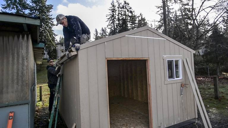 Rotary Club of Gig Harbor and Home Depot have donated a new storage shed to Key Peninsula's Angel Guild Thrift Shop. Photo: Peter Haley