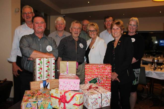 Nowra Rotarians with some of the Christmas boxes destined for the drought-affected areas of Forbes and Condobolin. Photo: contributed.