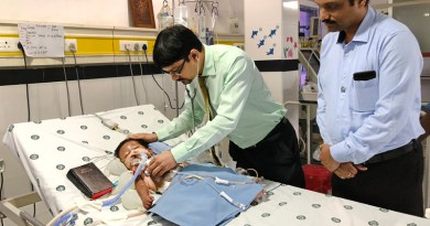 Dr Prashant Shah examines little Inba who has undergone a complicated surgery while RC Madras South President R Saravanan looks on.