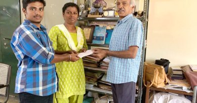 P L Muthiah, Chairman – Microloans, handing over the microcredit cheque to Prem and Preethisha.