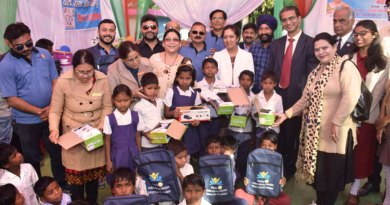 Footwear and school bags being distributed to children.