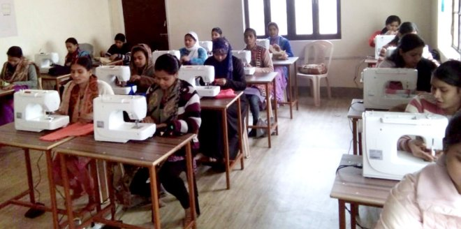 Women learn tailoring at the Rotary Singer Skill Development Centre.