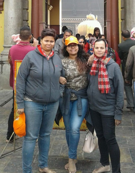 Smruti and Srushti, PDG Subodh Joshi's daughters, and wife Sneha at the Pashupatinath temple.