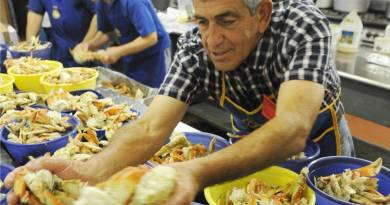 Rotarians getting busy with the annual Crab Feed, which provides the funds for many of the club's annual projects. Photo: Gene Lieb/losbanosenterprise.com