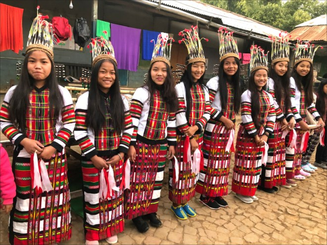 Girls dressed in traditional Manipuri costumes for an entertainment programme.