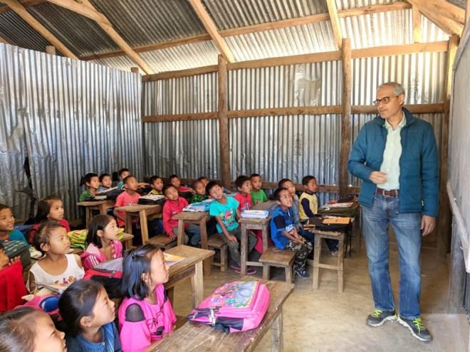 Aliasgar Janjali teaching children at the Ijeirong school.