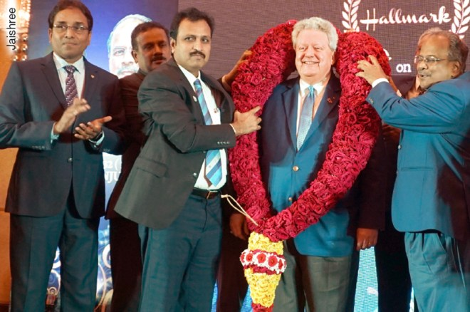 RIPE Maloney being felicitated by D 3232 DG Babu Peram and DGE G Chandramohan (right). DGN S Muthupalaniappan (left) is also in the picture.