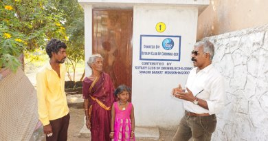 Project Chairman Ravi Kandasamy with a beneficiary family at the Kovalam village.