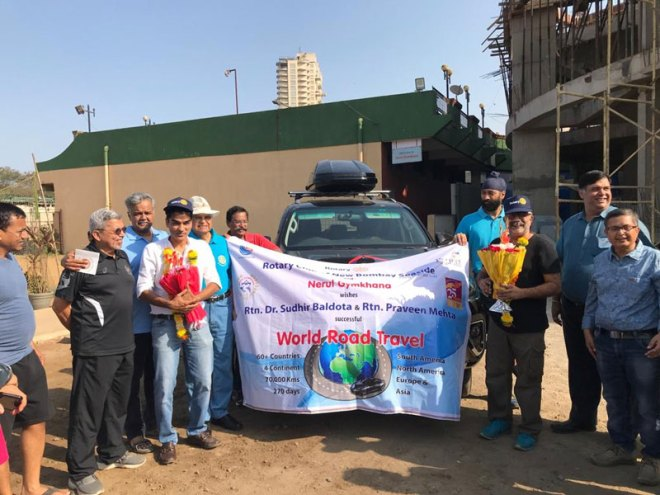 Dr Sudhir Baldota and Praveen Mehta (in white) with bouquets  during the flag-off of the car rally in Mumbai.