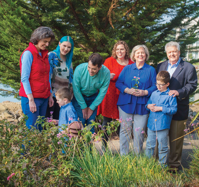 From left: Daughters Phyllis and Suzanna; grandson Peter; son-in-law Blake; daughter Margaret; Gay; grandson Patrick; and President Maloney.