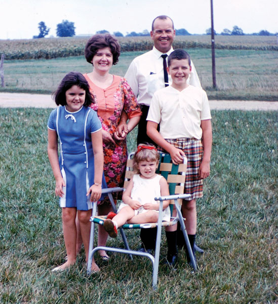RI President Maloney on the family farm in the mid-1960s, with his mother, Doreen, his father, Patrick, and his two sisters, Kristi (left) and Erin