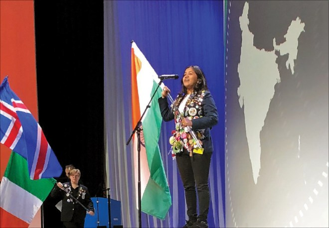 A Rotary Youth Exchange student represents India at the Flag Ceremony.