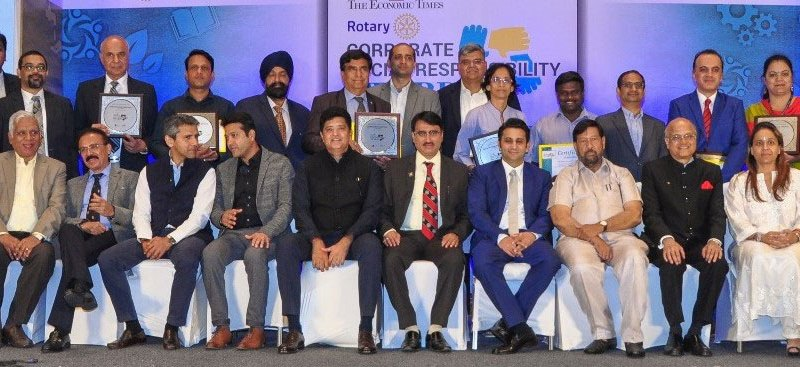 TRF Trustee Gulam Vahanvaty (seated third from R) and IPDG Shailesh Palekar (seated, centre)  with ­representatives of corporate houses and award winners.