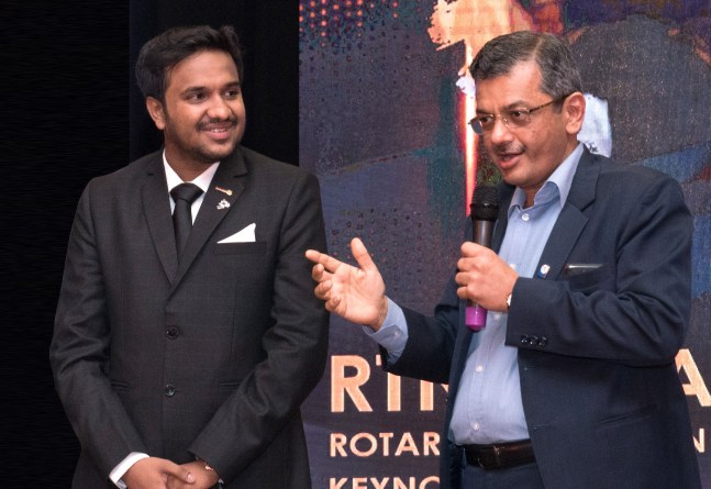 RI Director Bharat Pandya speaking at the Rotaract District Training Assembly. DRR Kushal Bhuva is also present.