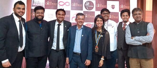 RID Pandya with IPDRR Hansika Shahani, DRR Kushal Bhuva, PDRR Om Chawla and other Rotaractors. PDG Prafull Sharma is on the right.