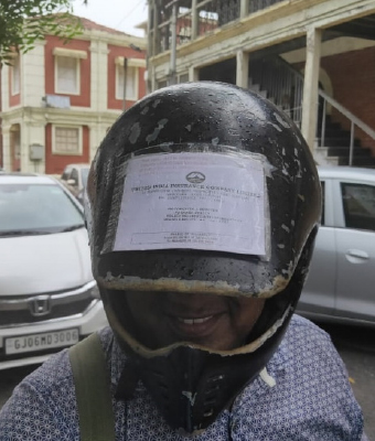 """A ready reckoner helmet With hike in penalties and tighter road traffic regulations under the amended Motor Vehicles Act, R Shah, a resident of Vadodara, has stuck his driving licence, registration certificate, insurance papers and other relevant documents on his helmet, lest he forgets them. """"Helmet is the first thing I put on before riding my bike. That's why I pasted all the documents there so that I don't face any fine,"""" he says. And a man in Aligarh was spotted wearing a helmet while driving a car, for he was fined for not wearing one while he was riding a two wheeler!"""