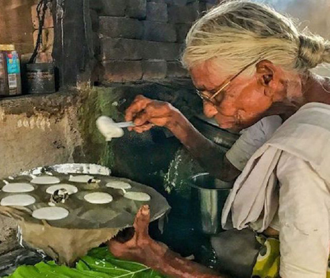 """Idlis for a rupee When news of eighty-year-old Kamalathal selling idlis for a rupee in Coimbatore went viral on social media, offers of help poured in for her. Taking note of her cooking the idlis on a firewood burner, industrialist Anand Mahindra tweeted, """"If anyone knows her I'd be happy to 'invest' in her business & buy her an LPG fueled stove."""" Soon both HPCL and BPCL came forward to offer LPG connection to the octogenarian. """"Salute the spirit and commitment of Kamalathal. Glad to have helped her through local OMC officers in getting LPG connection,"""" tweeted Union Minister for Petroleum and Natural Gas Dharmendra Pradhan."""