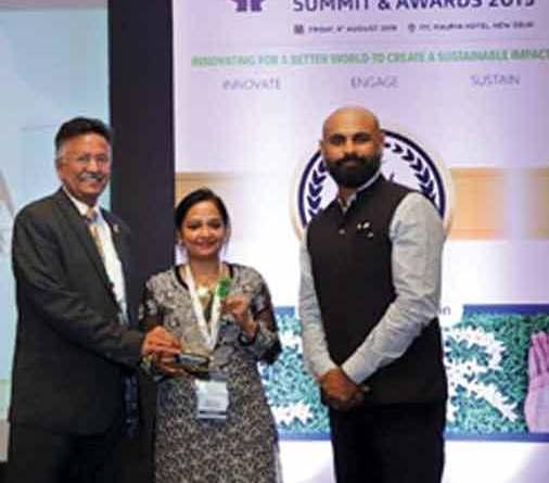 Head - TRF Sanjay Parmar and Senior Programme Associate Bhavna Verma receive the award from VP, Head of Communications - Corporate Affairs and CSR, Nissan India Abhishek Mahapatra.