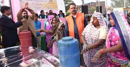 Villagers being trained in hand wash practice.
